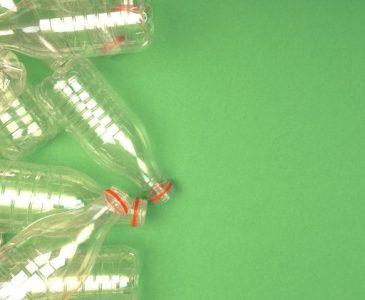 plastic water bottles, green background